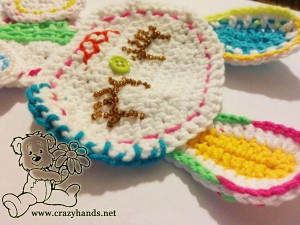 embroider eyes and legs with beads of the crochet bunny