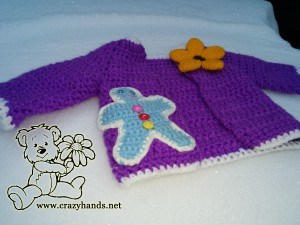 Crochet jacket with crochet gingerbread man and crochet flower