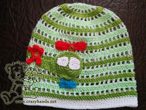 green boy's hat with crochet helicopter