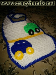 finished crochet baby bib with cars