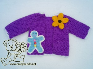 Crochet gingerbread man sewed to a crochet jacket