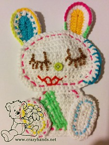 finished crochet bunny made with different colour threads