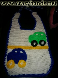 Crochet baby bib with cars