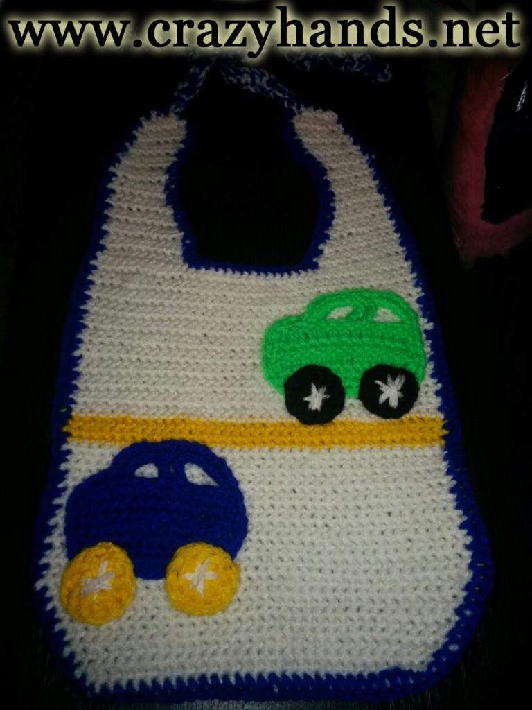 Crochet baby bib with cars
