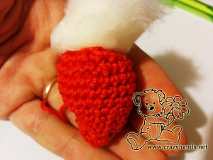 filling crochet strawberry with hollow fibre