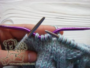 baby hat knitting pattern: cable four back knitting stitch - step #1
