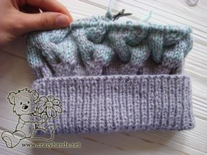 half knitted body of the baby hat