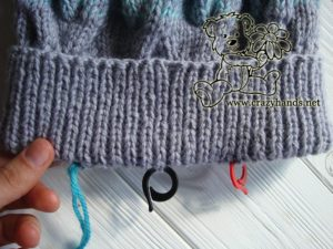 knitting the earflaps of the baby hat - step #1