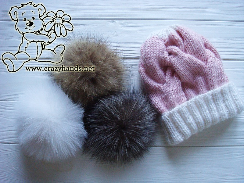 Pink Marshmallow Cable Knitted Hat with natural fur pom poms on the side