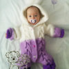 Baby in Knit Romper with Cables (photo one)