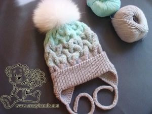 knitted baby hat with earflaps and fur pom pom