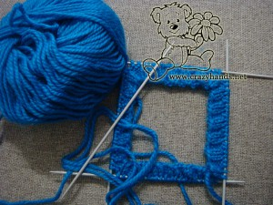 knitting the body of the winter hat on 4 needled