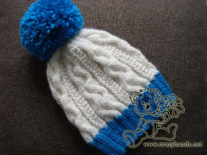 blue & white winter knitted hat with yarn pom pom