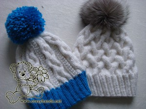 two winter knitted hats: blue & white with yarn pom pom, and white hat with silver fox fur pom pom