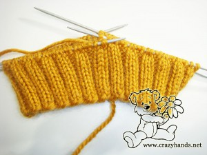 start the ribbing of the knitted hat pattern with cables