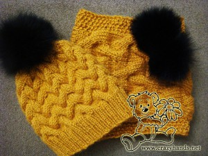 knitting set: cable knit hat and cable knit cowl with fur pom poms