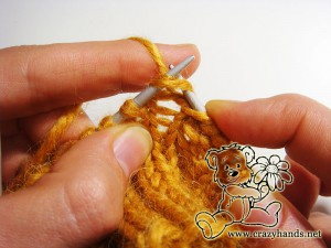 Knitting the third step in the round of increase