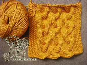 cabele knit cowl and a skein of yarn