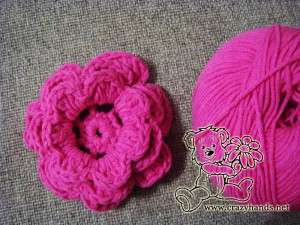 crochet flower for children's knit hat pattern and a skein of yarn