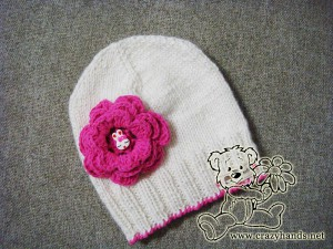 chidren's knitted hat with crochet pink flower