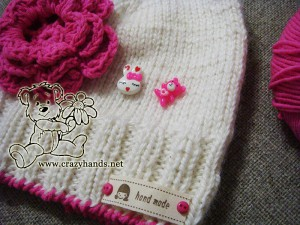 knit hat with three layer crochet flower