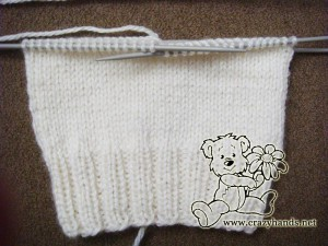 half-knit child's hat with a body length of 13-14 cm