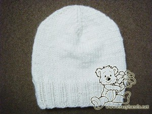 finished chidlren's knit hat of white color