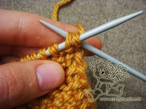 Bind off the stitches for the knitted headband pattern - step #1
