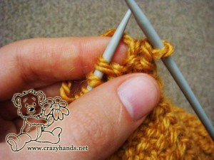 Bind off the stitches for the knitted headband pattern - step #3