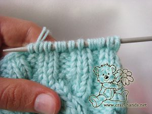 Knitting the earflaps of the baby hat pattern - step #1