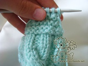 Knitting the earflaps of the baby hat pattern - step #2