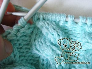 Earflap baby hat knitting pattern: cable three front knitting stitch - step #3