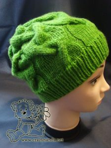 Easy knit hat pattern: finished cable hat - side view on the mannequin