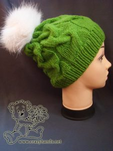 Easy to knit cable hat with white fur pom pom