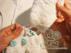 underarm holes while joing the sleeves of baby raglan sweater