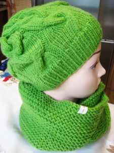 infinity knitting scarf and matching knitting hat on the mannequin - back view