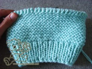 Half-knitted baby hat with a width of about 10-11 cm from the edge