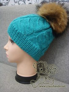 azure cable hat with raccoon fur pom pom