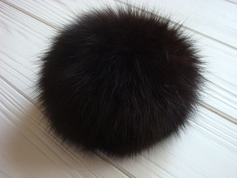Dark and light brown pom pom