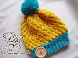 Swedish-styled knit har with yarn pom pom