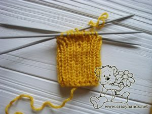 Knitting the ribbing of the mittens for a newborn baby