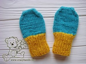 A pair of baby knit mittens