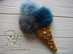 knit ice cream with fur pom poms and round buttons
