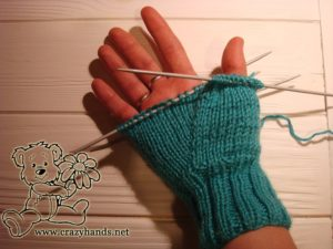 Half-finished body of the knit mitten