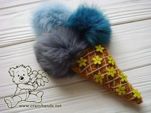 knit ice cream with fur pom poms and butterfly buttons
