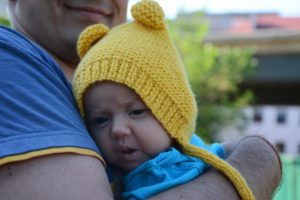 three-months-old-baby-in-knit-bonnet-photo-1