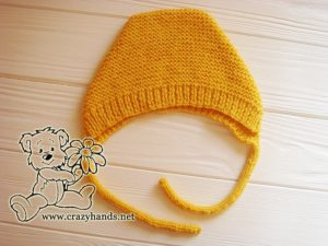 adding-ties-to-baby-knit-bonnet-photo-1