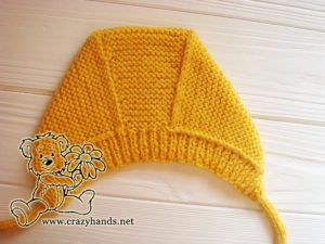 adding-ties-to-baby-knit-bonnet-photo-2