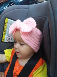 girl wears knit bow headband