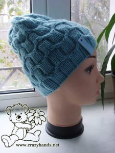 Knit cable hat on mannequin